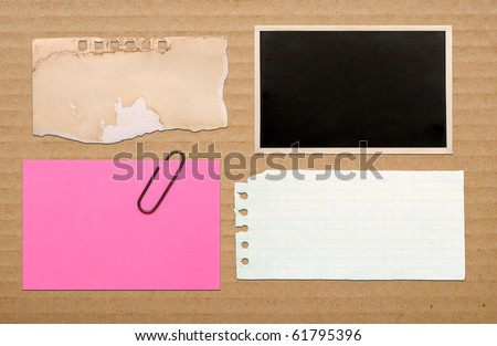 vintage notes on brown cardboard background - stock photo