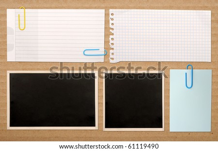 vintage notes over brown cardboard background - stock photo