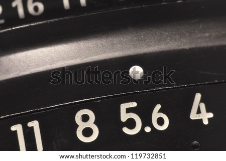 vintage objective lens macro with apertures scale, shallow DOF; focus on 5.6 number - stock photo