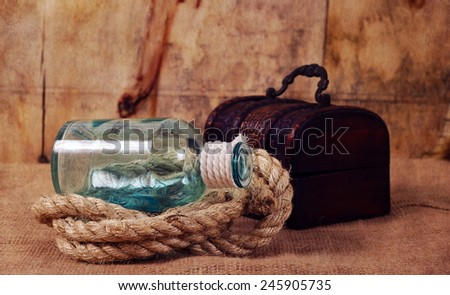 vintage objects,bottle,rope and chest  - stock photo