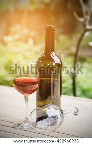 vintage of Bottle of white wine,  on wooden table - stock photo