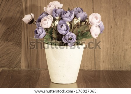 vintage of bouquet of purple rose on wood background - stock photo