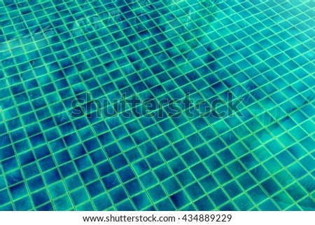 vintage of green ceramic stair in swimming pool - stock photo