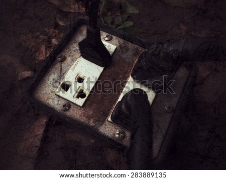Vintage of old dirty electrical outlet in the power cord is connected. - stock photo