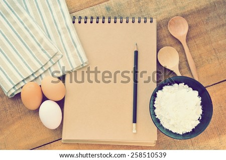 Vintage of the old blank cook  book with ingredients of cake. - stock photo