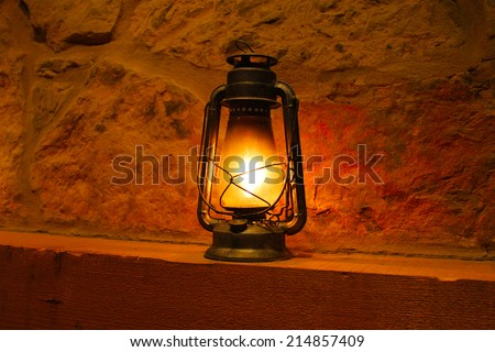 Vintage oil lamp in a dark room - stock photo