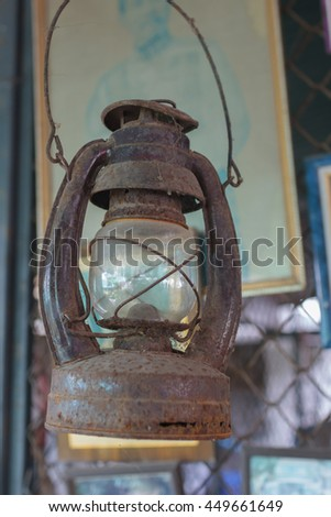 Vintage oil lamp,The old lamp hangs,on blur background - stock photo