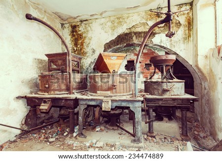 Vintage old abandoned winery, old equipment and grape presses. Sardinia Italy - stock photo