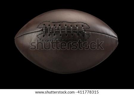 Vintage old American Football on Black - stock photo