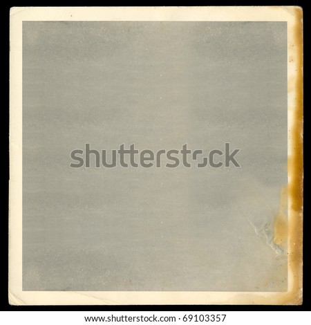 Vintage old blank burned photograph design element with white border. - stock photo