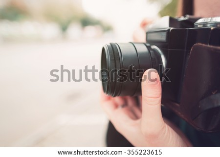 vintage old camera. photographing on the street - stock photo