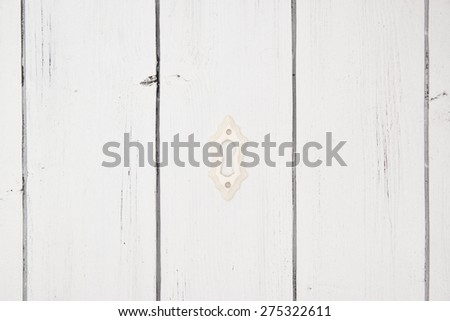 Vintage old classic ivory keyhole on a white wooden background. Symbol of privacy and secret. Shabby chic style theme - stock photo