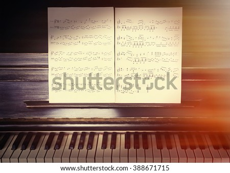 Vintage old classic piano with musical notes, close up - stock photo