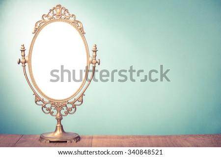 Vintage old desk mirror frame. Retro style filtered photo - stock photo