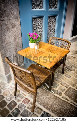 Vintage old fashioned cafe chairs with table in Copenhagen, Denmark - stock photo