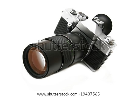 Vintage old film camera with telephoto lens