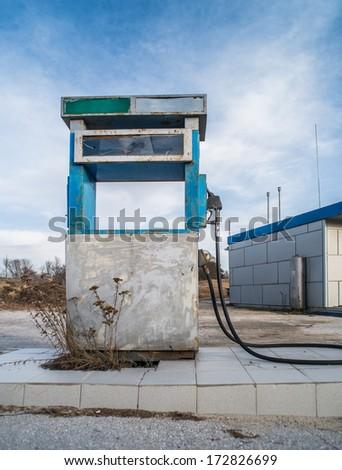 Vintage old gas pump on blue sky - stock photo
