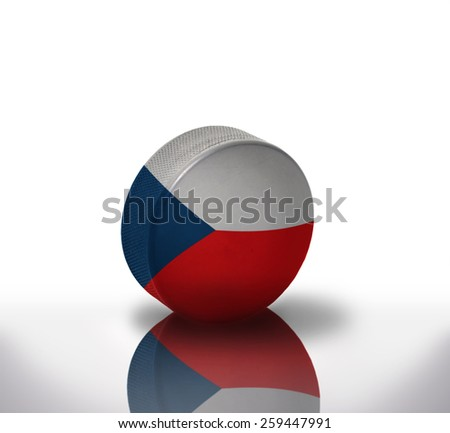 vintage old hockey puck with the czech flag - stock photo