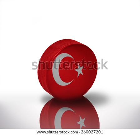vintage old hockey puck with the turkish flag - stock photo
