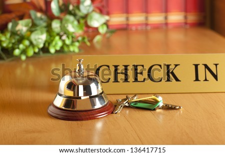 Vintage old hotel bell on the table - stock photo