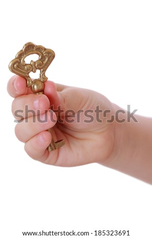 vintage old key in little girl hand - stock photo