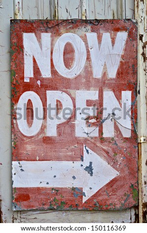 Vintage old Now Open Sign with arrow - stock photo