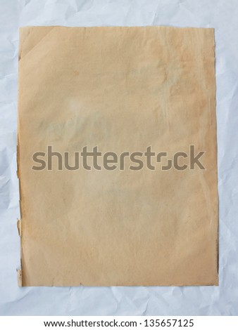 vintage old paper on crumpled paper background.