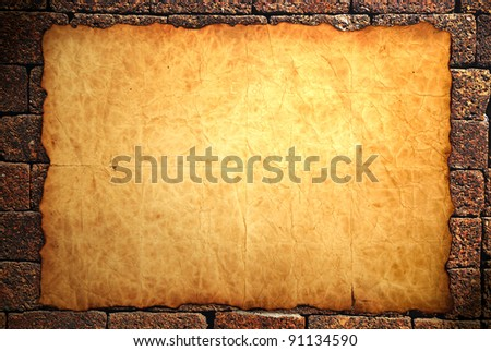 Vintage old paper on wall background - stock photo