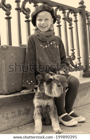 Vintage old photo of a little girl and his dog - stock photo