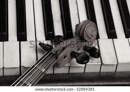 Vintage old Piano and violin head part - stock photo