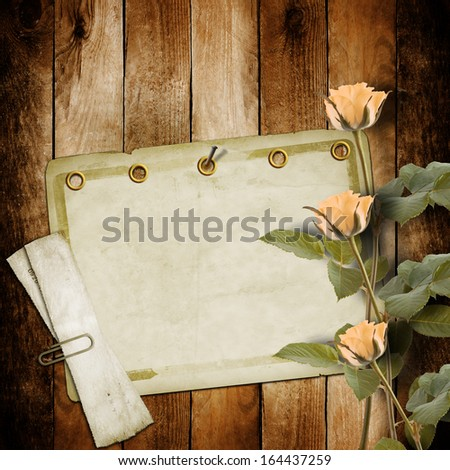 Vintage old postcard for congratulation with pink roses on wooden background - stock photo