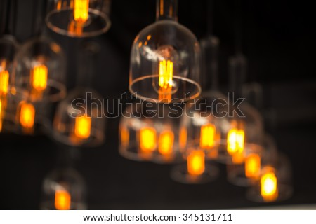 Vintage old style light bulb blur for background.