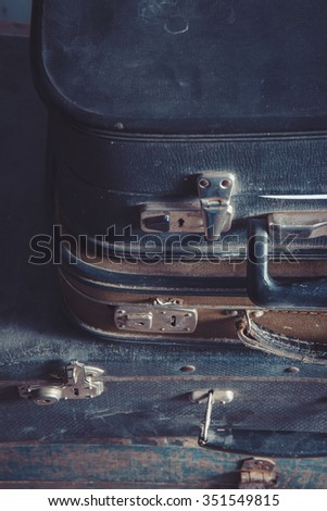 Vintage old suitcases  on top of each other