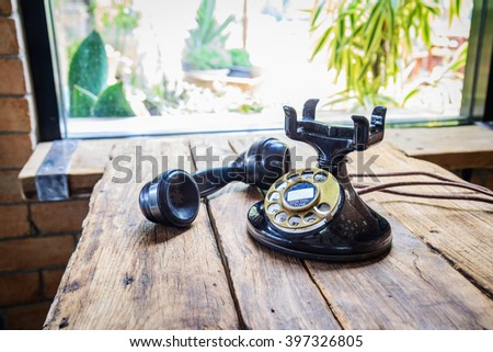 Vintage old telephone on wood table