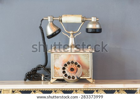 Vintage old telephone with binoculars concept still life. - stock photo