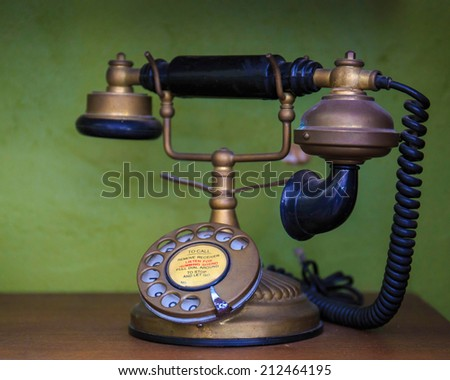 Vintage old telephone with binoculars conceptual still life. - stock photo