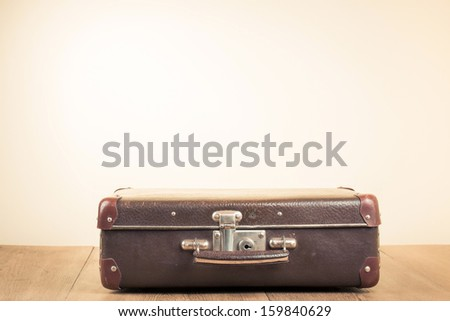 Vintage old travel suitcase on floor with empty space for text - stock photo