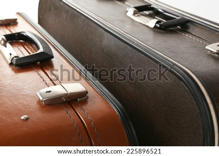 Vintage old travel suitcases, close up - stock photo