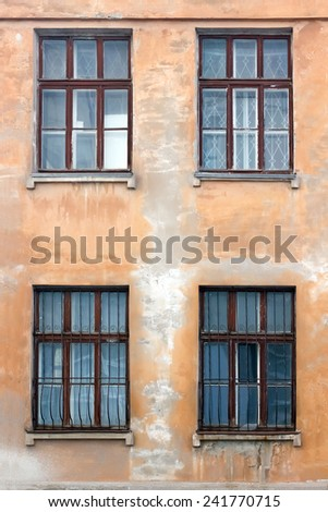 Vintage old wall and four windows - stock photo