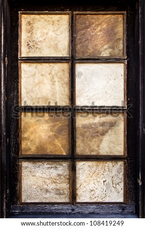 vintage old window frame with leather panels - stock photo