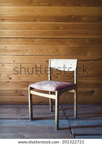 Vintage old wooden chair in grungy interior. - stock photo