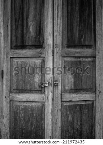 Vintage old wooden door in Chiang Khan, Loei, Thailand - stock photo