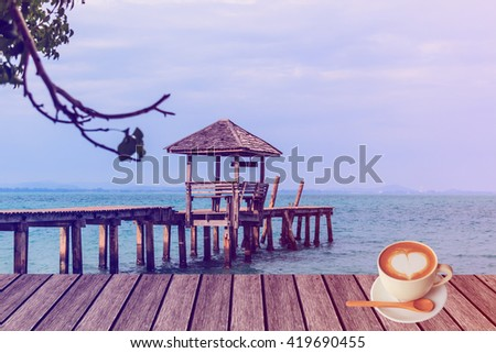 vintage old wooden pavilion and tropical sea with mock up and latte coffee. - stock photo