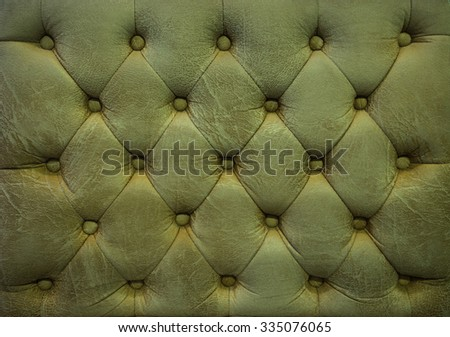 Vintage olive-green leather upholstery buttoned sofa (background) - stock photo