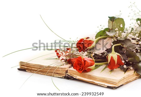 vintage open book with bouquet of roses on white background - stock photo