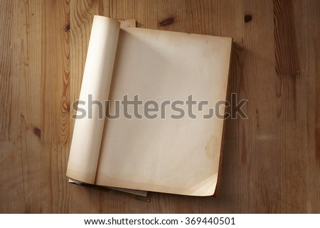 Vintage open book with soft shades on wood