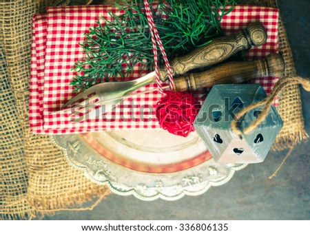 Vintage or rustic christmas table setting. Toned image - stock photo