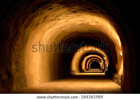 Vintage or under construction tunnel with dynamic visual effect made by the light of lanterns