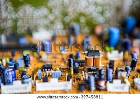 Vintage orange printed circuit board PCB with many electrical components, soft focus - stock photo