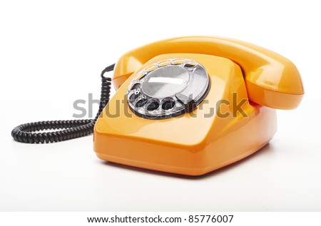 vintage orange telephone isolated over white background - stock photo